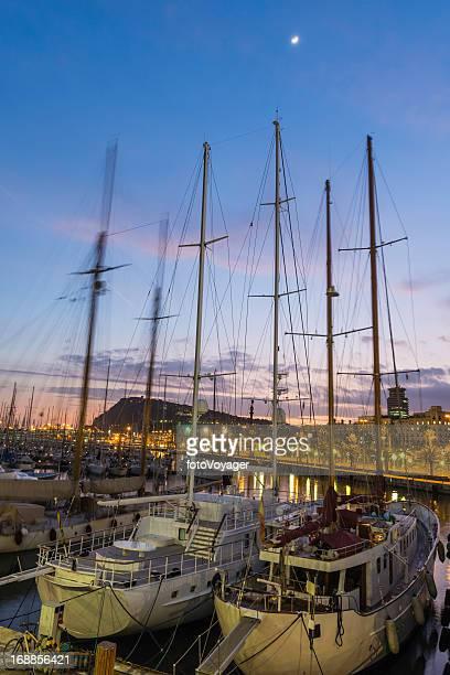 Barcelona Port Vell yacht marina waterfront illuminated at night Spain