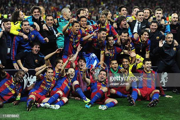 Barcelona pose for photographs as they celebrate victory in the UEFA Champions League final between FC Barcelona and Manchester United FC at Wembley...