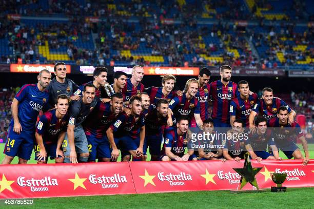 Barcelona pose with the trophy at the end of the Joan Gamper Trophy match between FC Barcelona and Club Leon at Camp Nou on August 18 2014 in...