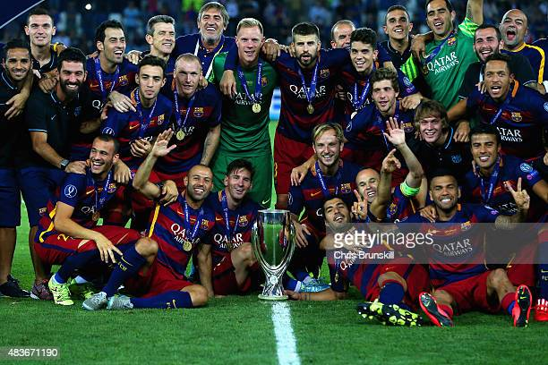 Barcelona pose with the UEFA Cup trophy after victory in the UEFA Super Cup between Barcelona and Sevilla FC at Dinamo Arena on August 11 2015 in...
