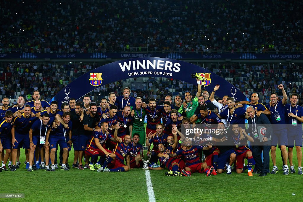 Barcelona pose with the UEFA Cup trophy after victory in the UEFA Super Cup between Barcelona and Sevilla FC at Dinamo Arena on August 11, 2015 in Tbilisi, Georgia.