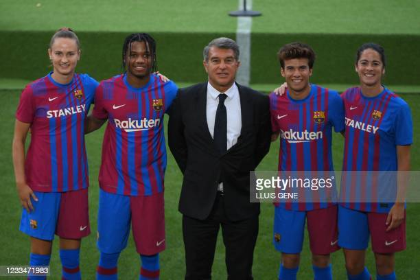 Barcelona president Joan Laporta poses with Barcelona's Norwegian forward Caroline Graham Hansen, Barcelona's Spanish midfielder Ansu Fati...