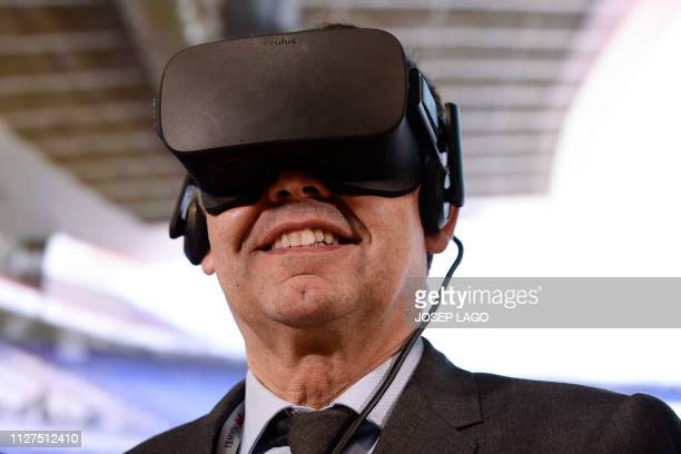 Barcelona president Josep Maria Bartomeu tests a virtual reality headset during a presentation of a project between the club, Telefonica, GSMA and...