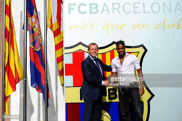 Barcelona President Sandro Rosell and Alex Song shake hands after signing for FC Barcelona at Camp Nou on August 20 2012 in Barcelona Spain