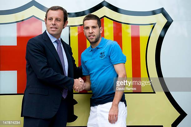 FC Barcelona President Sandro Rosell and Jordi Alba shake hands during the official presentation of Jordi Alba as the new signing for FC Barcelona at...