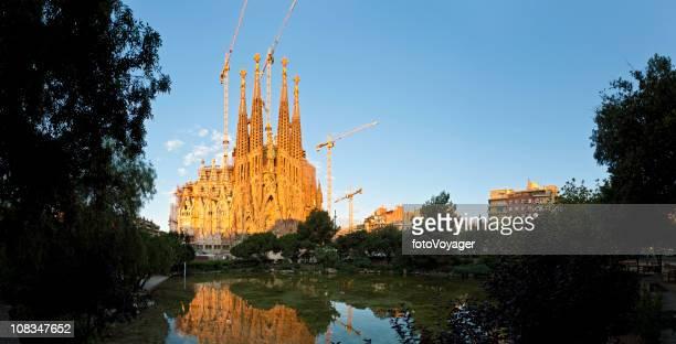 Barcelona Sagrada Familia dawn light golden stone reflected Catalonia Spain