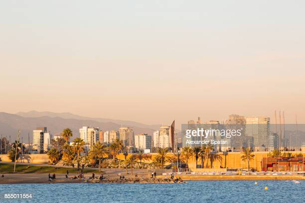 Barcelona skyline and beach with palm trees Catalonia, Spain