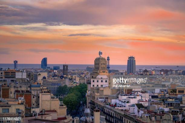 barcelona skyline at sunset, spain - tibidabo stock pictures, royalty-free photos & images