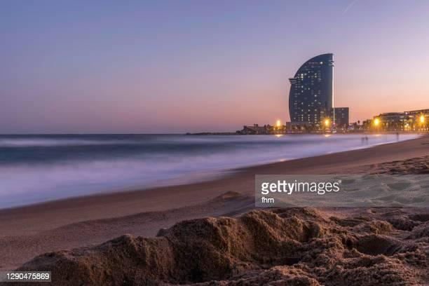 barcelona skyline on the beach(catalonia/ spain) - la barceloneta stock-fotos und bilder
