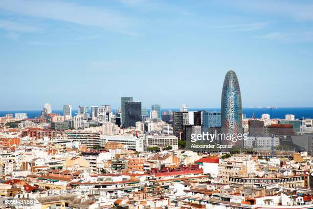 barcelona skyline with torre agbar and blue sky - barcelona fotografías e imágenes de stock