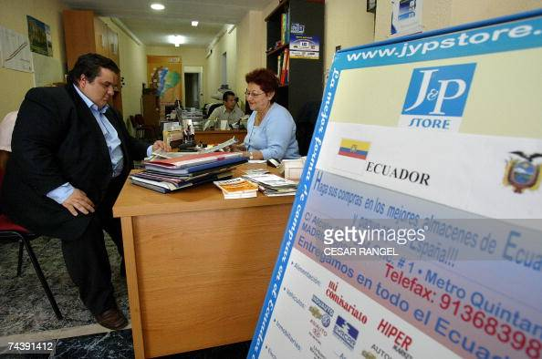 A man purchases items at a JYP store in Barcelona, 01 June