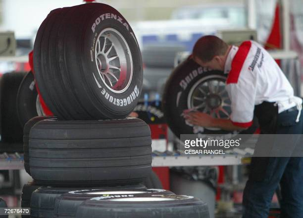 A mechanic checks a Bridgestone tyre used during the Formula One test sessions at the Catalonia racetrack in Montmelo near Barcelona 28 November 2006...