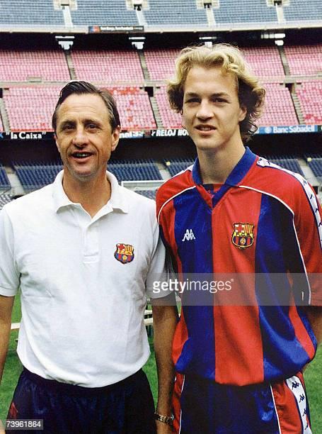 Picture taken 03 June 1995 shows Dutch football star Johan Cruyff posing with his son Jordi in Barcelona. Johan Cruyff will turn sixty on 25 April...