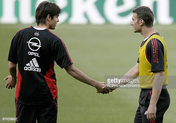 AC Milan's Andrij Shevchenko shakes hands with teammate Kaka during a training session at the Camp Nou stadium in Barclona 25 April 2006 on the eve...