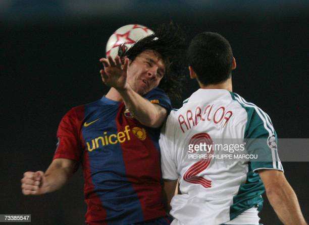Barcelona's Argentinian forward Lionel Messi vies with Liverpool's Spanish defender Alvaro Arbeloa during the first leg of a last 16 Champions League...