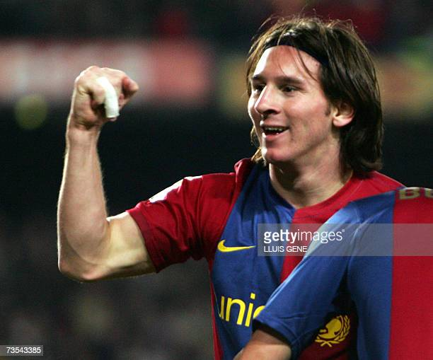 Barcelona's Argentinian Leo Messi celebrates after scoring his third goal against Real Madrid during a Spanish league football match at the Camp Nou...
