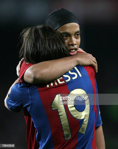 Barcelona's Argentinian Leo Messi celebrates with Brazilian Ronaldinho after scoring his third goal against Real Madrid during a Spanish league...