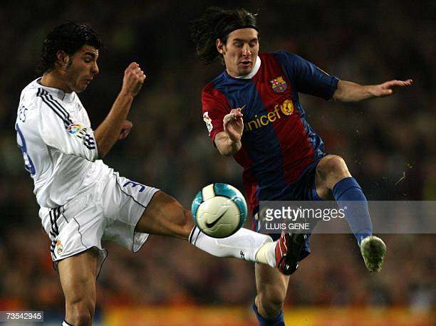 Barcelona's Argentinian Leo Messi vies with Real Madrid's Torres during a Spanish league football match at the Camp Nou stadium in Barcelona 10 March...