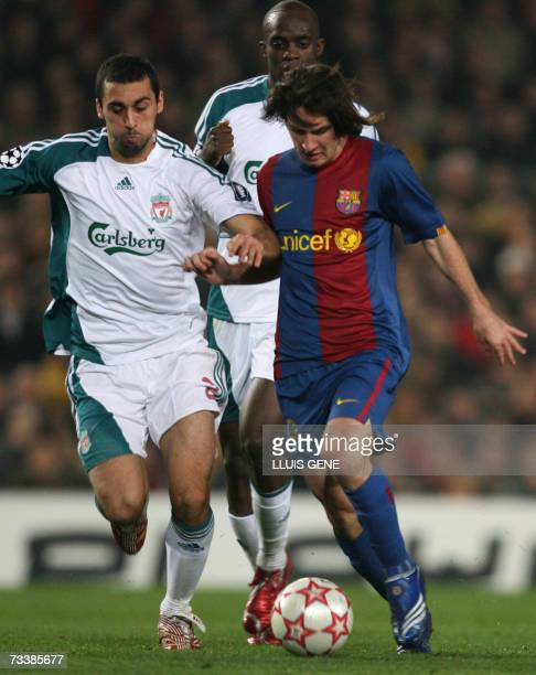 Barcelona's Argentinian Lionel Messi vies with Liverpool's Alvaro Arebola during the first leg of a last 16 Champions League football match at the...