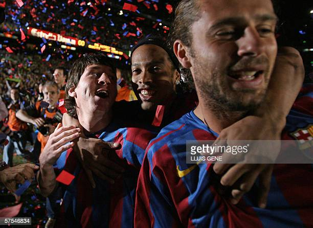 Barcelona's Argentinian Messi Brazilian Ronaldinho and Mexican Marquez celebrate after winning the Spanish league and beating Espanyol at the Camp...