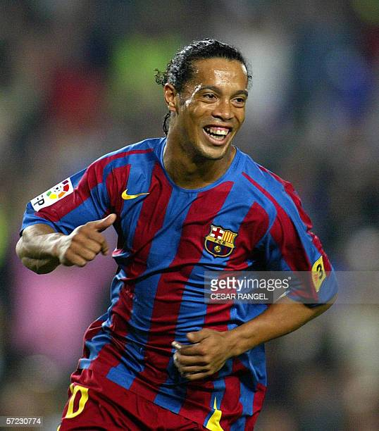 Barcelona's Brazilian Ronaldinho celebrates after scoring from the penalty spot to make it 10 against Real Madrid during their Spanish league...
