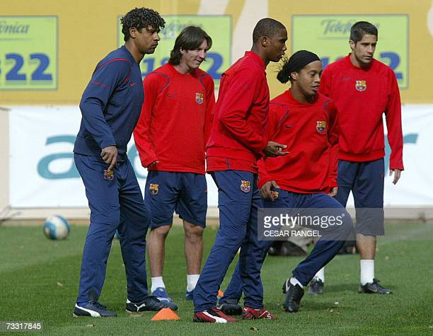 Barcelona's coach Frank Rijkaard Lionel Messi Samuel Eto'o of Cameroon and Brazilian Ronaldinho take part in a training session at the Camp Nou...