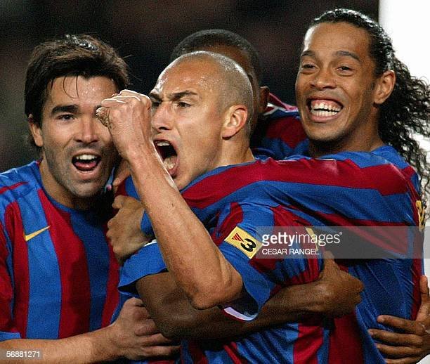 Barcelona's Henrik Larsson celebrate after scoring a goal with his team mates Deco and Ronaldinho against Betis during their Spanish League football...