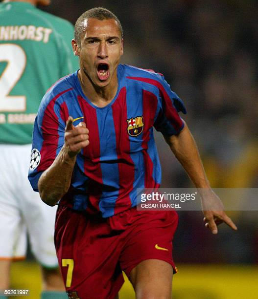 Barcelona's Henrik Larsson celebrates after scoring a goal against Wender Bremen during their Champions League football match at the Nou Camp in...