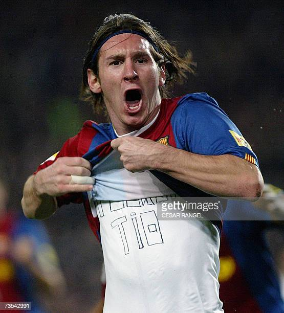 Barcelona's Leo Messi celebrates after scoring his second goal against Real Madrid during a Spanish league football match at the Camp Nou stadium in...