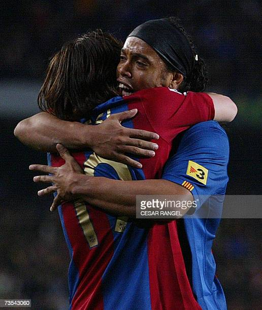 Barcelona's Leo Messi is congratulated by Ronaldinho after scoring his second goal against Real Madrid during a Spanish league football match at the...