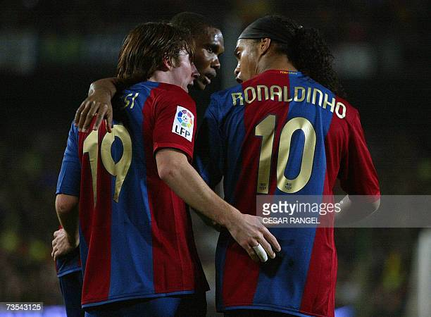 Barcelona's Leo Messi is congratulated by Ronaldinho and Samuel Eto'o after scoring his second goal against Real Madrid during a Spanish league...