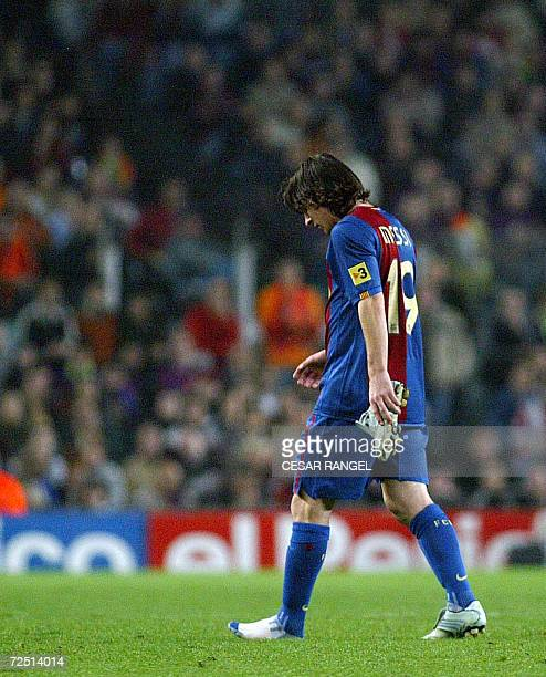 Barcelona's Leo Messi of Argentina leves the field after being injured during a Spanish League football match against Zaragoza at the Camp Nou...