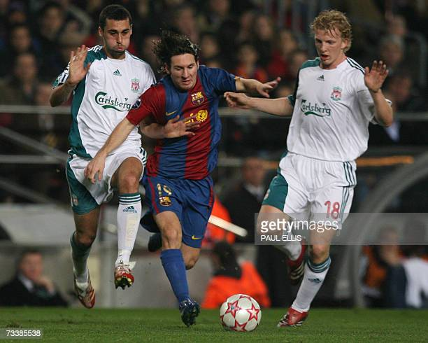 Barcelona's Lionel Messi pushes past Liverpool's Alvaro Arbeloa and Dirk Kuyt during the first leg of a last 16 Champions League football match at...