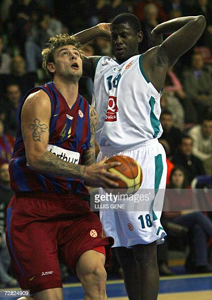 Barcelona's Mario Kasun vies with Pau Orthez Michael Wright during the EuroLeague basketball Group C match at the Palau Blaugrana in Barcelona 14...