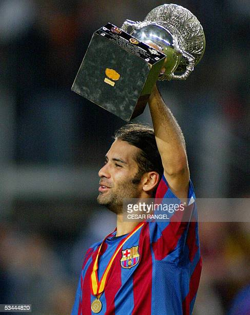 Barcelona's Mexican Rafael Marquez holds the trophy after winning the Spanish SuperCup soccer match in Barcelona 20 August 2005 AFP PHOTO/CESAR RANGEL