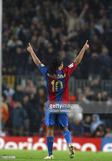 Barcelona's Ronaldinho de Asis celebrates after scoring a goal against Zaragoza during their Spanish League football match at the Camp Nou Stadium in...