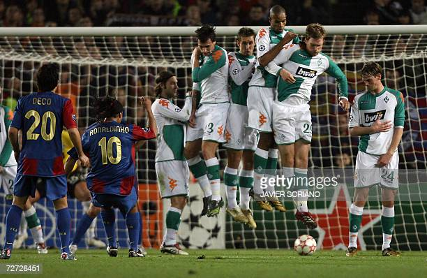 Barcelona's Ronaldinho shoots and scores from a free kick in front of a wall of Werder Bremen players during a Group A Champions League football...
