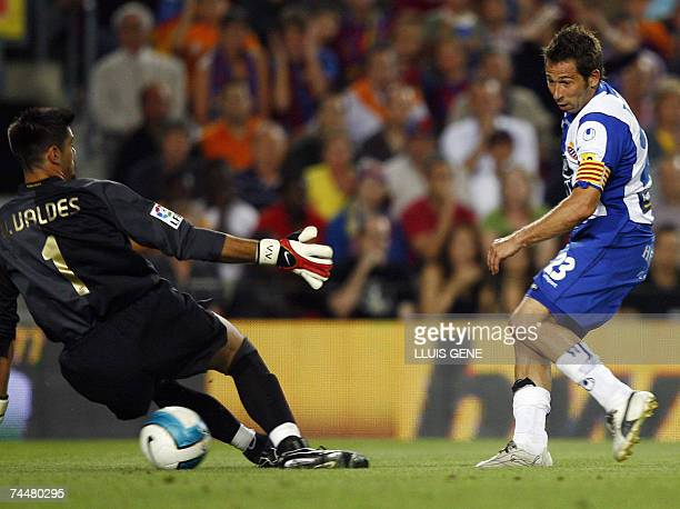 Espanyol's Raul Tamudo shoots and scores past Barcelona's goalkeeper Victor Valdes during a Spanish league football match at the Camp Nou stadium in...