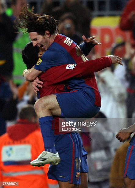 FC Barcelona's Aegentinian Leo Messi and Brazilian Ronaldinho celebrate the first goal against Deportivo during their Spanish League football match...