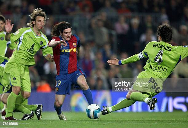 FC Barcelona's Argentine Leo Messi vies with Belenguer and Alexis before scoring the second goal against Getafe during their Spanish King's Cup...