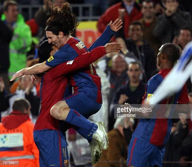 FC Barcelona's Argentinian Leo Messi Brazilian Ronaldinho Cameronian Samuel Eto'o celebrate the first goal against Deportivo during their Spanish...