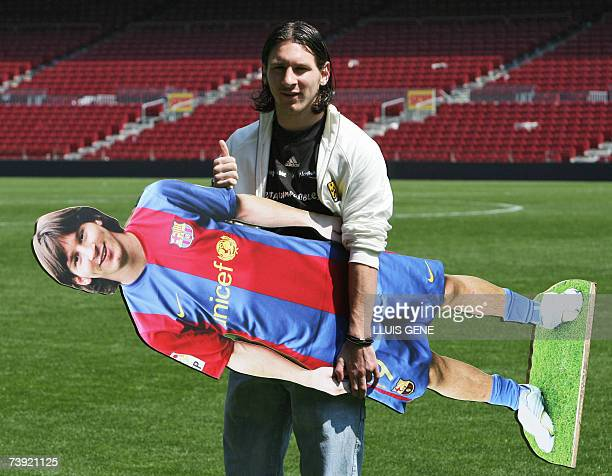 FC Barcelona's Argentinian Leo Messi poses with his portrait at Camp Nou stadium 19 April 2007 in Barcelona Messi scored yesterday against Getafe a...