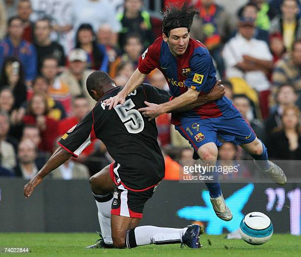 FC Barcelona's Argentinian Leo Messi vies with Levante's Alvaro during their Spanish League football match at Camp Nou stadium in Barcelona 29 April...