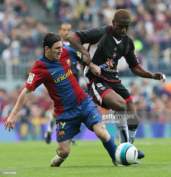 FC Barcelona's Argentinian Leo Messi vies with Levante's French Kapo during their Spanish League football match at Camp Nou stadium in Barcelona 29...
