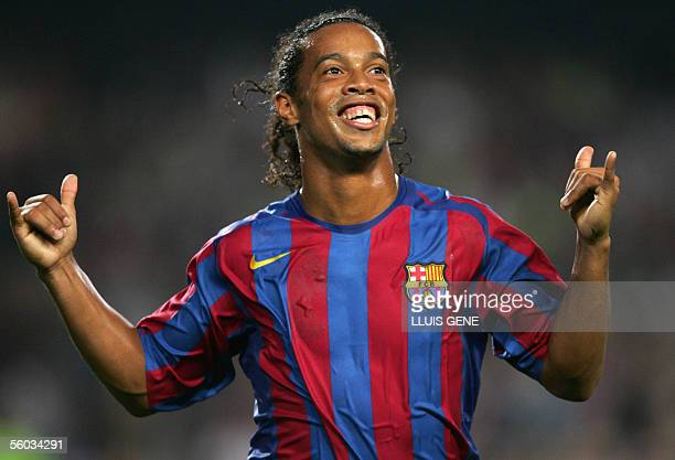 FC Barcelona's Brazilian Ronaldinho celebrates the second goal against Real Sociedad during their Spanish League football match at the Camp Nou...