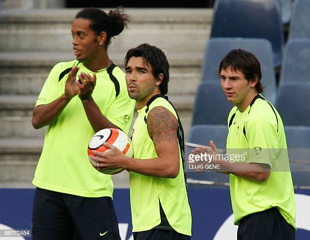 FC Barcelona's Brazilian Ronaldinho Portuguese Deco and Argentinian Leo Messi stretch during a training session at the Camp Nou stadium in Barcelona...