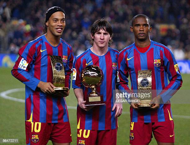 FC Barcelona's Brazilian Ronaldinho Samuel Eto'o of Cameroon hold the trophies of FIFA World Player of the Year and Argentinian Leo Messi with his...