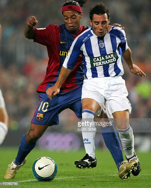 FC Barcelona's Brazilian Ronaldinho vies with Recreativo de Huelva's Cazorla during their Spanish League football match at Camp Nou stadium in...