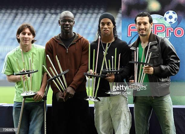FC Barcelona's football players Argentinian Leo Messi French Lilian Thuram Brazilian Ronaldinho and Italian Gianluca Zambrotta show their 'FIFPRO...