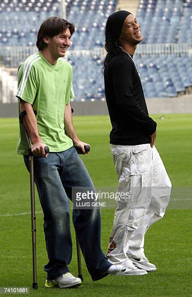 FC Barcelona's football players Argentinian Leo Messi and Brazilian Ronaldinho joke before the delivery of the FIFPRO awards at Camp Nou Stadium 24...